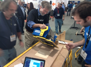 ShopBot Founder and CEO Ted Hall demonstrates the Handibot Smart Tool