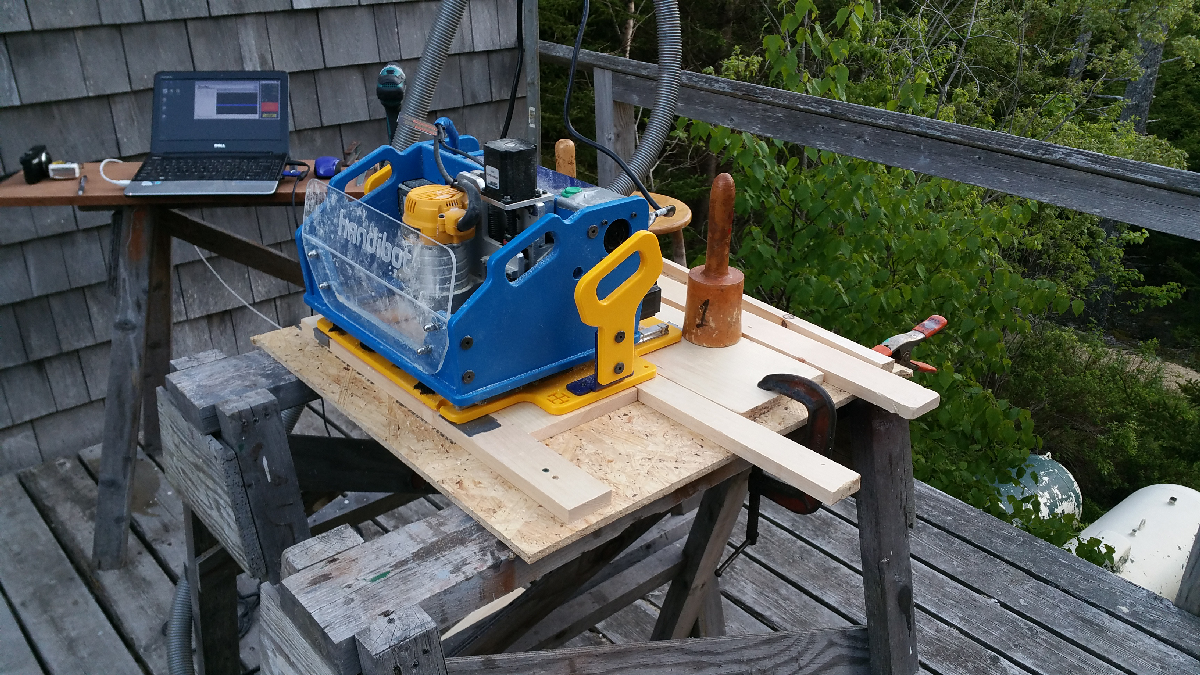 Handibot set up for tiling. Note project material against lower fence, clamped with wedge at top