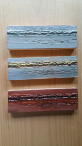 Three sample tests of colors for painting of the carvings (each is a small, identical replica of full size carving)