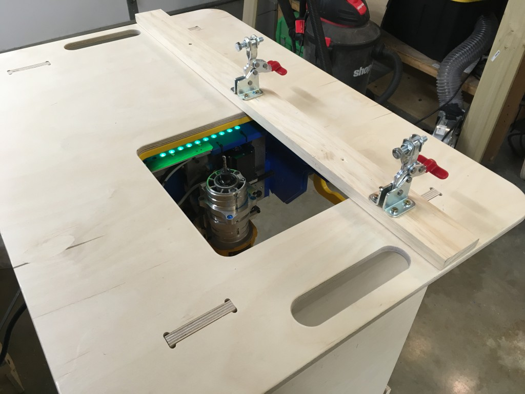 The bench top with the fence and toggle clamps installed
